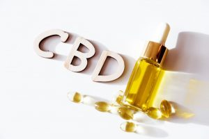 CBD with product and softgels